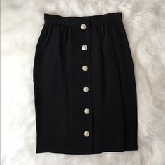 ❗️LAST CHANCE YSL Rive Gauche High Waisted Skirt There are no words to describe how stunning and perfect this is in person. It retails for $1,190 so please keep that in mind when making offers. It's in PERFECT condition, no stains or flaws at all. Its equal to about a size 6 in American sizes. It's perfect for any season and any occasion. It's lined. The buttons go all the way from top to bottom and there's no zipper. It has pockets which is great. 14 inches across the waist and 24.5 inches…
