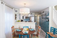 Beach Flip contestants Melissa and Mahdi transformed a run-down beach condo into a bright, modern space. See the stunning transformation room by room.
