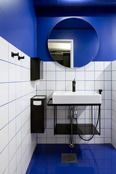Blue paintwork matched with white square tiles. Bathroom design by Sistem Interior Architects. Office Interior Design, Office Interiors, White Square Tiles, Interior Architects, Bathrooms, Sink, Mirror, Projects, Blue