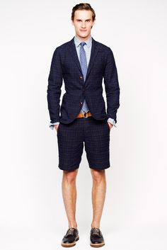 Unlined Navy Linen Blazer, Chino Shorts, Lace Up Brogues, and Orange Belt. Men's Spring Summer Fashion.