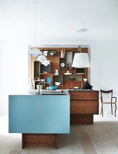 Great custom designed wood and blue kitchen cabinetry