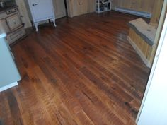 Custom Circle Sawn Hickory Floors, with a custom made stain.  Made by Superior Floors 518-623-2874