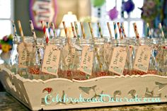 "Alice in Wonderland Party Beverage bottles with colorful straws and ""Drink Me"" tags.  #aliceinwonderland #partydrinks #wonderlandparty #aliceinwonderlandpartyideas"