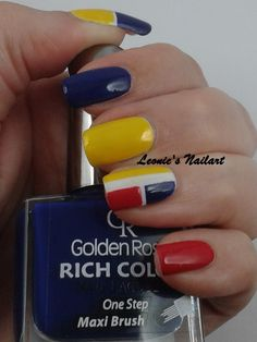 #31dc2 Day 4: Primary colors. The base is #chinaglaze White on White. Golden Rose nr 16 for the blue Sinful Colors Let's Meet for the yellow and Kleancolor Red Alert for the red. It looks a bit like a Mondriaan painting ;) Leonie's Nailart