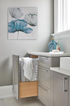 Glossy gray laundry room cabinets
