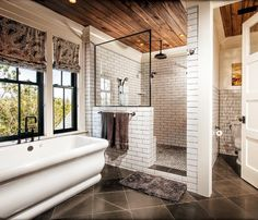 vessel bath with white subway tile and black grout. love the black framed windows and dark hardware too.