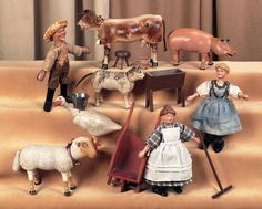 """American farm set by Schoenhut, ca. 1910.  Each of the people (8"""" tall) has painted gesso over paper mache heads with sculpted and painted features and hair,wooden articulated body with slitted hands and feet for posing.  The animals include glass-eyed cow with horns and udder, painted eye lamb with leather ears and wooden tail, painted eye goose, painted eye pig with leather ears and tail, and a glass eyed cat (tail not original).  Along with trough, wheel barrow and three legged milking…"""