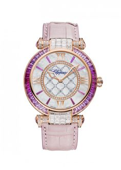 Chopard IMPERIALE 40 mm Watch 18k rose gold, pink sapphires and diamonds.his IMPERIALE timepiece in 18k rose gold is a sparkling feast of color. A bezel of pink sapphires and glowing diamonds encircle an elegant mother-of-pearl dial, on which rose sapphire indexes and stately rose-gold hands and Roman numerals take center stage. A regal rose leather strap adds the finishing touch to this utterly unique timepiece