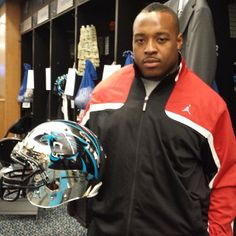 from Carolina Panthers FB Mike Tolbert shows off a custom chrome #Panthers helmet he received as a gift during locker clean out day.