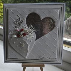 Beautiful! One cutout heart, one heart folded with flowers inside