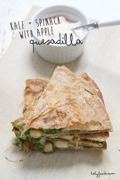 A filling and healthy version of your standard quesadilla - filled with a  kale, spinach and apple spread and loaded with beans and cheese for a  complete meal that most toddlers (and parents) can't resist!!