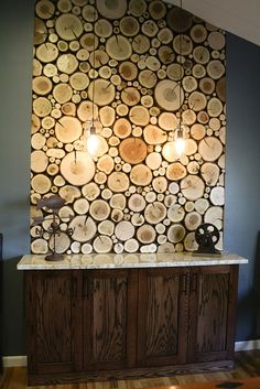 Create a similar wall panel of logs using log tiles from www.thelogbasket.co.uk.
