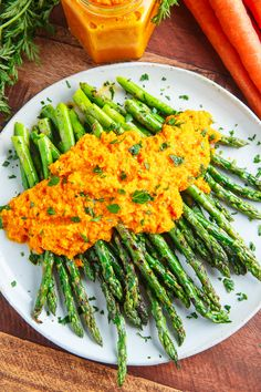Are you ready for another side dish for your Easter dinner? How about this tasty grilled asparagus with carrot ginger dressing? With spring here, even though it's still chilly here, there is asparagus Carrot Ginger Dressing, Carrot And Ginger, Carrot Recipes, Vegetable Recipes, Vegetarian Recipes, Grilled Asparagus, Asparagus Recipe, Roasted Carrots, Dressing Recipe