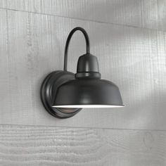 """Count on a stylish and sophisticated source of radiant light in this metal indoor-outdoor wall light fixture. 11 1/4"""" high x 8 1/2"""" wide. Extends 10 1/2"""" from wall. Backplate is 6 1/4"""" wide. Shade is 8 1/2"""" wide x 4 1/4"""" high. Weighs 1.54 lbs.  Uses one maximum 72 watt bulb (incandescent, LED, or CFL). Bulb not included. Style # 13F64 at Lamps Plus."""