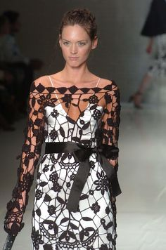 Laura Biagiotti.  http://outstandingcrochet.blogspot.com/2012/03/laura-biagiotti-crochet-tunic-and-dress.html