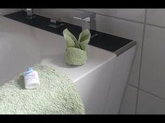 Handtuch dekorativ zum Hasen falten – Anleitung Handtuchtiere / Waschlappen / Badetücher - YouTube Bathroom Towels, Bath Mat, Youtube, Home Decor, Towel Animals, Wrap Gifts, Household, Happy Easter, Bath Linens