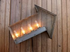 Steel arrow wall sign steampunk light by HitandMissLimited on Etsy, $125.00