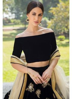 Navy Blue and Gold Off Shoulder Velvet Lehenga features a navy blue velvet blouse, embroidered velvet lehenga and net dupatta. Zari and stone embellishments are present on this style. Source by shoulder Blouses Lehenga Choli, Lehenga Indien, Blouse Lehenga, Lengha Blouse Designs, Black Blouse Designs, Sarees, Sari Design, Indian Fashion Dresses, Indian Designer Wear
