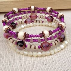 🌿 Purple & Ivory, agate boho wrap bracelet 🌿 🆕 Purple and Ivory wrap around memory wire bracelet handmade from agate, shell, and wood beads, complemented with lavender, violet, purple, ivory, brown beads and copper caps. It wraps 4 times on wrist One size fits all 🌿 bohemian style jewelry 🌿 Jewelry Bracelets