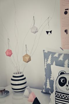 Geo Christmas decoration...I would do something like this just to have year round :) Like these colors/vase/pillows