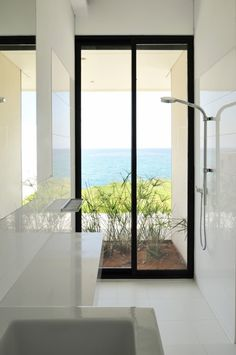 Known as a wet room, this no glass shower integrates beautifully into this modern home.