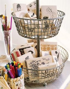 A long time ago Pottery Barn came out with a 3 tiered wire basket that I saw in their catalog and I remember totally falling in love with it...