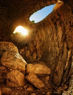 """""""God's eyes (Prohodna cave)"""" Prohodna Cave is one of the most famous and easily accessible caves in Bulgaria.The cave is a natural 262 m long rock bridge Places To Travel, Places To See, Scenery Pictures, Gods Eye, Mysterious Places, Kirchen, Science And Nature, Natural Wonders, Amazing Nature"""