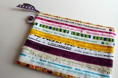 "Patchwork Selvage Pouch: Celebrate the selvage rather than throwing it away. Great inspiration for a DIY! 8 3/4"" x 6"". $20"