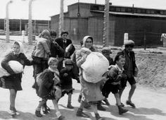 Birkenau, Poland, May 1944, Women and children deemed unfit for work, on their way to gas chamber no. 4.