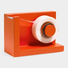 This tape dispenser has a sticky polyurethane gel base which secures it to any surface so it stays put when dispensing tape, allowing for one-handed operation. Includes one roll of tape. Colorful Desk, Moma Store, Shop Class, Tape Dispenser, Task Lamps, New Gadgets, Desk Accessories, Minimal Design, Cool Things To Buy