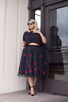 Gabi Fresh softens a sexy crop top with a sweet kiss-printed skirt. I would wear something like this for Valentine's Day to make my beau's jaw drop to the floor.  #plussizefashion #gabifresh #valentinesday