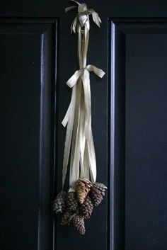 Love the Pine Cones with Ribbon-so simple & sweet. Use red ribbon and cinnamon scented pine cones for a non-cluttered but classy front door Christmas decoration; could also be placed onto windows (indoor) and cabinets (instead of a wreath). Decoration Christmas, Noel Christmas, All Things Christmas, Winter Christmas, Hygge Christmas, Diy Decoration, Christmas Ideas, Decor Ideas, Contemporary Christmas Decorations