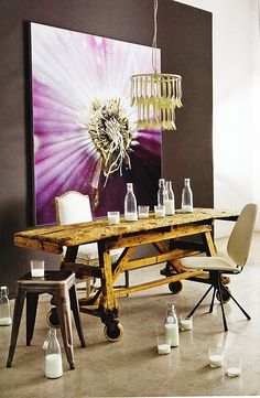 vintage rolling dining table~Industrial chic..  cool lighting with gold silverware. Huge abstract photo.