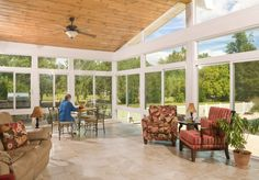 Ideas. Shiny Sun Room Design With Chic Motive Curtains Ideas. Spacious Sun Room Design With Brown Couch Combined Floral Motive Arm Chairs Also Wooden Chairs Unify Striped Cushioning And Wrought Iron Dining Room Set Under Ceiling Fan Ideas