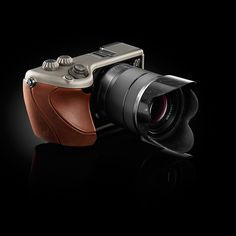 Hasselblad Lunar Camera - Creating some of the most expensive cameras in the world, Hasselblad has released an updated version of their prized Lunar model- boasting real wood finish, 27MP sensor, and a whole slew of top of the line features you can't afford.