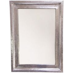 Hammered aluminum and a polished chrome finish make this chic, rectangular wall mirror stand out.