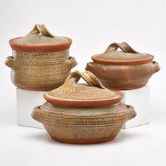 "KAREN KARNES Three lidded casserole dishes, Vermont, ca. 1970s; Glazed stoneware; Chopmark KK; Largest: 9"" x 14"" dia."