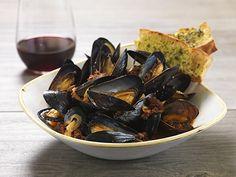 PEI MUSSELS @ Salt Creek Grille Garlic, Shallots, White Wine, Chorizo & Tomato Broth, Toasted Focaccia