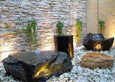 Formal rock fountain for indoor area.