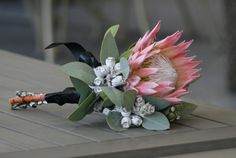 Australian native flowers bouquet. I would add some pink or white Leptospernum, and a mix of white, pink and red peonies and roses