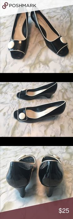 Etienne Aigner black patent peep-toe wedges, Sz 8 Black patent leather peep-toe wedges from Etienne Aigner. Ivory colored piping and button add sophisticated interest. Only worn a couple times. Single scuff mark as shown in pic. Otherwise Excellent used condition. Etienne Aigner Shoes Wedges
