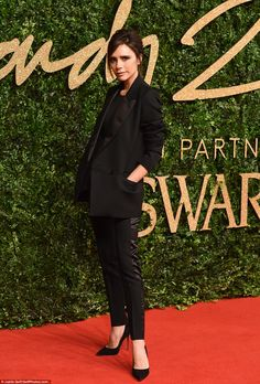Style queen! The 41-year-old fashion designer looked chic in a trouser suit and pointed black suede stilettos