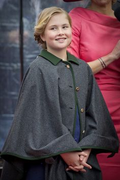 Princess Catharina-Amalia, the eldest daughter of King Willem-Alexander and Queen Máxima, wore a cape as well, though her's was dark grey.