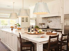 Love this long wide island great for seating, entertaining, cook prep and the great 3 large shades
