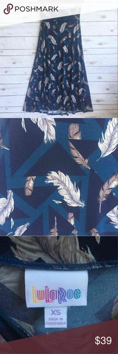 """NWT LULAROE Maxi Skirt Feathers Geometric NWT LULAROE Maxi Skirt Feathers Geometric  Blue, Navy with brown feathers 38"""" long  Thank you for looking and please check out the rest of my closet. LuLaRoe Skirts Maxi"""