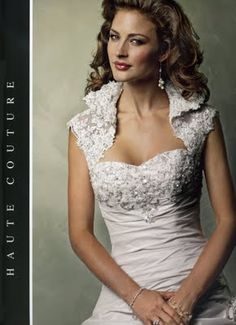 Maggie Sottero Sabelle bolero that matches my dress BUT I am cutting it up to put in my vintage rose and brooch bouquet.