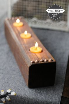 This beautiful reclaimed cedar wood tea light holder is perfect for three tea lights. Each round hole is 1 5/8 wide. The wood holder measures