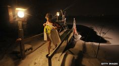 Why Finns love Saunas - BBC - Finnish woman emerges from a frozen lake to return to the sauna