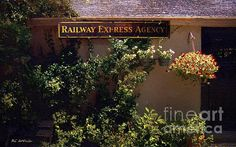 """Charming Whimsy"" ~ © 2016 RC deWinter ~ A patio garden surrounds a rustic garden shed sporting an antique railroad sign; available in a variety of media, sizes and configurations."