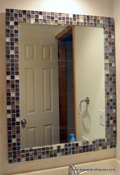 Time to update my guest bathroom! For my first project I updated the old boring mirror with some glass tile. It turned ou. Bathroom Mirror Makeover, Bathroom Mirrors, Shower Shelves, Bathroom Shelves, Room Tiles, Bathroom Renos, Bathroom Ideas, Bathroom Colors, My New Room